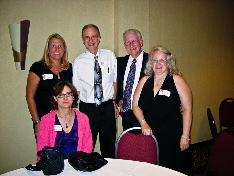 Sitting - ---- Doyle wife; Background Left- Carol Mortimer Olivieri, Tom Goeller, wife Goeller