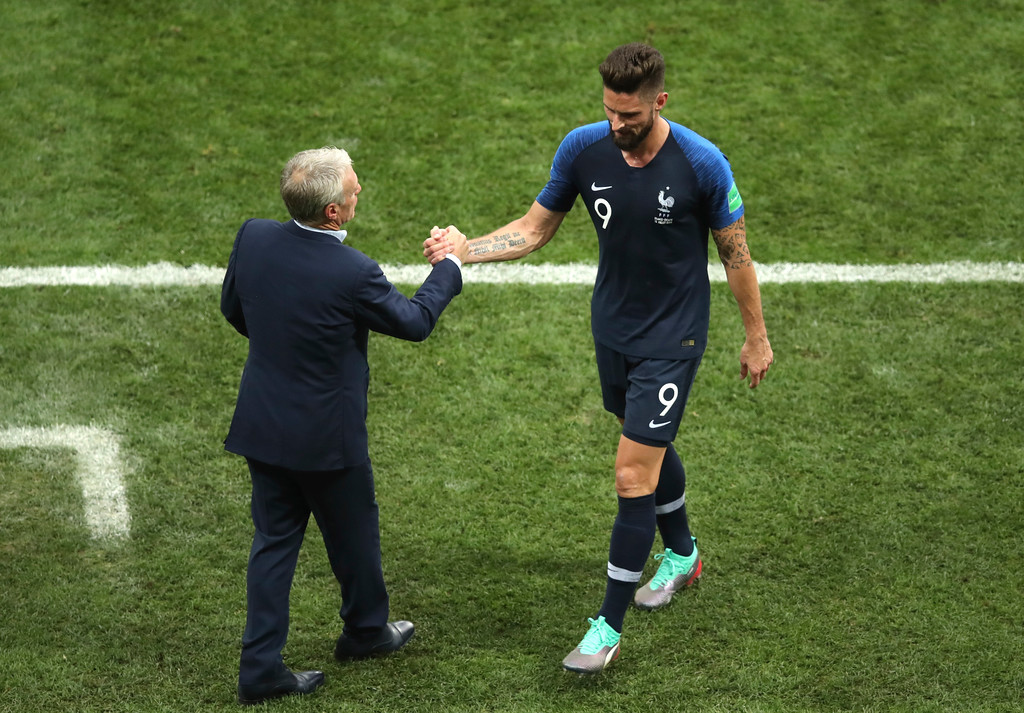 . France head coach Didier Deschamps shakes hand with France\'s Olivier Giroud after he was substituted during the final match between France and Croatia at the 2018 soccer World Cup in the Luzhniki Stadium in Moscow, Russia, Sunday, July 15, 2018. (AP Photo/Thanassis Stavrakis)