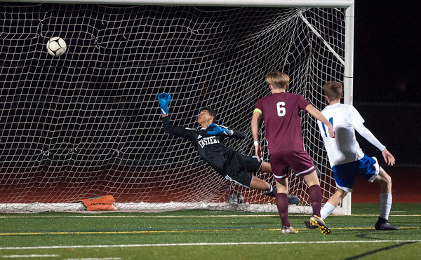 10/29/18 Wesley Bunnell | Staff Bristol Central boys soccer vs Bristol Eastern on Monday night in a game played at Bristol Central High School. Eastern Goal keeper Nate DiLoreto (1) dives but is unable to stop a first period goal.