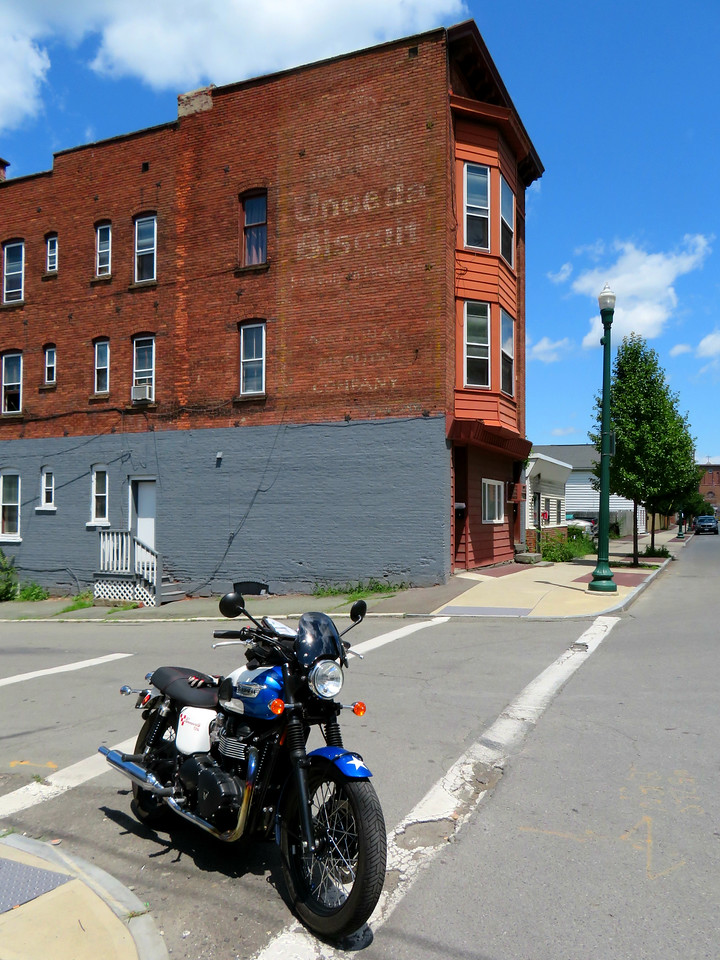 uneeda biscuit ghost sign and triumph bonneville in troy new york