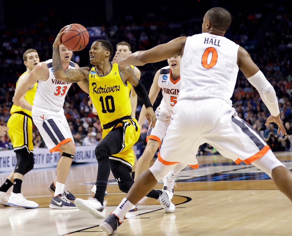 . UMBC\'s Jairus Lyles (10) drives past Virginia\'s Devon Hall (0) during the second half of a first-round game in the NCAA men\'s college basketball tournament in Charlotte, N.C., Friday, March 16, 2018. (AP Photo/Gerry Broome)