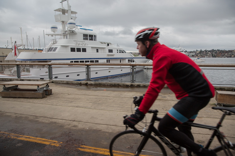 Lake Union in the heart of Seattle  is accessible to Puget Sound and the ocean via a ship canal so mega-yachts  moor along the lake shore, providing an impressive view for cyclists  on the adjacent bike path.