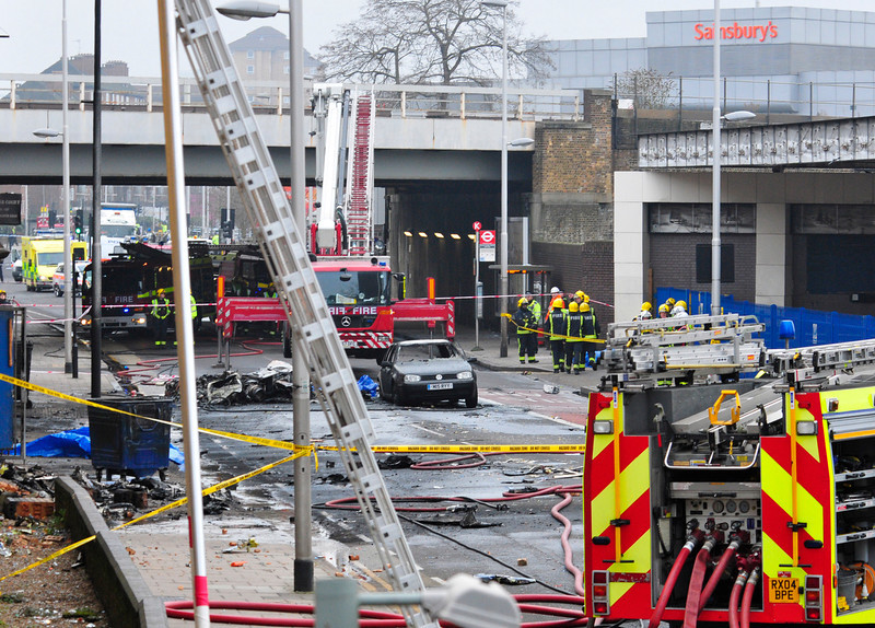 . Debris lies on the ground after a helicopter crashed into a construction crane on top of St George\'s Wharf tower building, in London, Wednesday Jan. 16, 2013. Police say two people were killed when a helicopter crashed during rush hour in central London after apparently hitting a construction crane on top of a building. (AP Photo/Vince Pol)