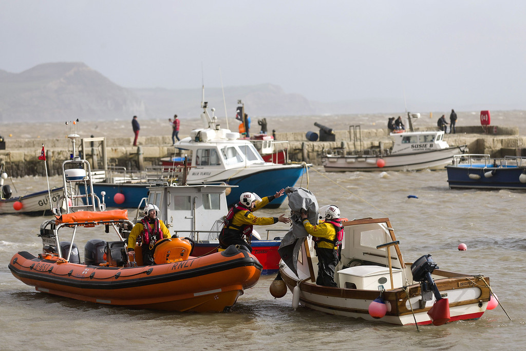 . Royal National Lifeboat Institution (RLNI) workers check boats in a harbour in Lyme Regis, southern England on October 27, 2013 in preparation for an expected storm. Britain was braced on October 27 for its worst storm in a decade, with heavy rain and winds of more than 80 miles (130 kilometres) an hour set to batter the south of the country.    JUSTIN TALLIS/AFP/Getty Images
