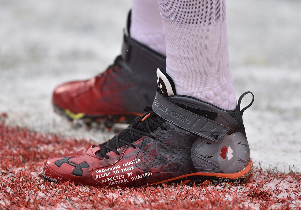 . Cleveland Browns tackle Joe Thomas cleats are shown before an NFL football game between the Cincinnati Bengals and the Cleveland Browns, Sunday, Dec. 11, 2016, in Cleveland. (AP Photo/David Richard)