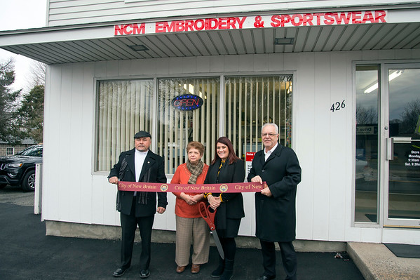 02/05/20 Wesley Bunnell | StaffrrNCM Embroidery Sportswear held its official ribbon cutting on Wednesday February 4, 2020 at its 426 Southington Main St location. NCM Embroidery Sportswear is owned by Nancy Mariano whose husband ran a barber shop at the same location. Alderman Willie Pabon, Owner Nancy Mariano, Mayor Erin Stewart and Economic Development Director Bill Carroll.