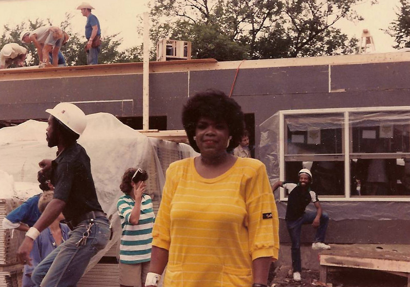 1985 Oprah Winfrey comes out to lend a hand one day at the Jimmy Carter Work Project where housing was built for 4 families in Chicago. Chris Fuller is working in doorway behind Oprah.  Sandra G.
