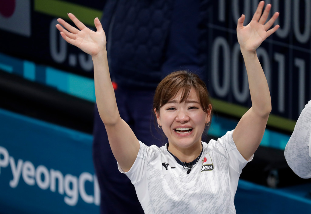 . Japan\'s Chinami Yoshida, waves to the crowd after defeating Britain in their match for bronze at the women\'s curling match at the 2018 Winter Olympics in Gangneung, South Korea, Saturday, Feb. 24, 2018. Japan won the bronze. (AP Photo/Aaron Favila)