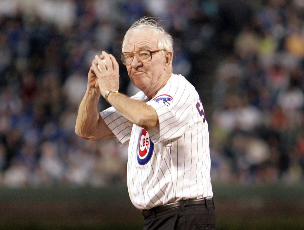 . FILE - In this Sept. 14, 2005, file photo, U.S. Supreme Court Justice John Paul Stevens winds up to throw out the first pitch before the start of the Chicago Cubs game with the Cincinnati Reds,  at Wrigley Field in Chicago. John Paul Stevens has rooted for the Chicago Cubs his whole life. And in this case, that\'s really something. How many fans can say they went to the very first World Series game at Wrigley Field? (AP Photo/Jeff Roberson, File)