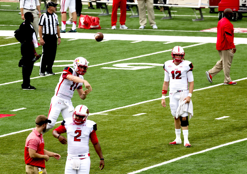 The three Lamar quarterbacks are warming up.   Earp is throwing.