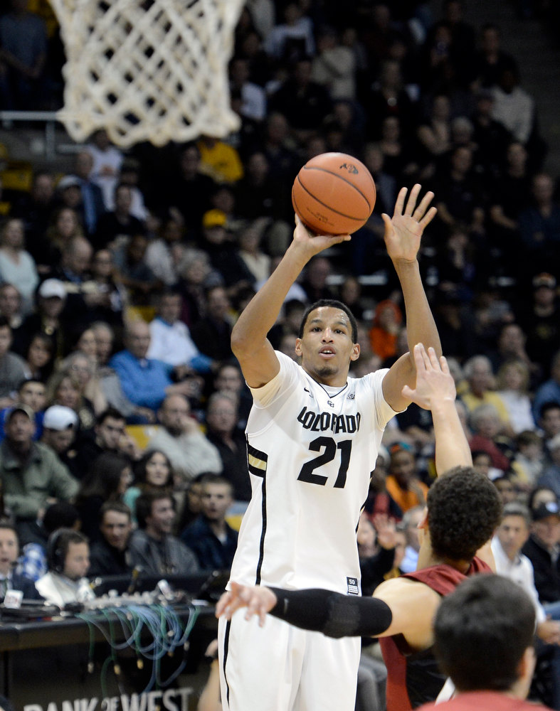 . University of Colorado\'s Andre Roberson shoot a three-pointer over Dwight Powell during a game against Stanford on Thursday, Jan. 24, at the Coors Event Center on the CU campus in Boulder. Jeremy Papasso/ Camera