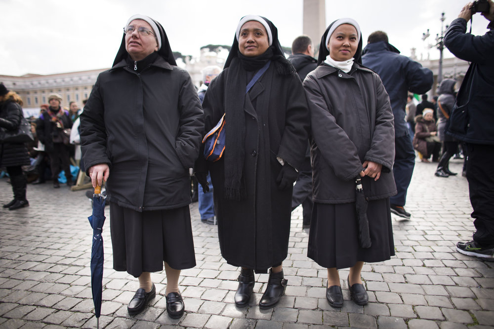 . Nuns wait for Pope Benedict XVI to deliver his last Angelus Blessing on February 24, 2013 in Vatican City, Vatican. Pope Benedict XVI delivers his last Angelus Blessing from the window of his private apartment to thousands of pilgrims gathered in Saint Peter\'s Square on February 24, 2013 in Vatican City, Vatican. The Pontiff will hold his last weekly public audience on February 27, 2013 before he retires the following day. Pope Benedict XVI has been the leader of the Catholic Church for eight years and is the first Pope to retire since 1415. He cites ailing health as his reason for retirement and will spend the rest of his life in solitude away from public engagements.  (Photo by Carsten Koall/Getty Images)