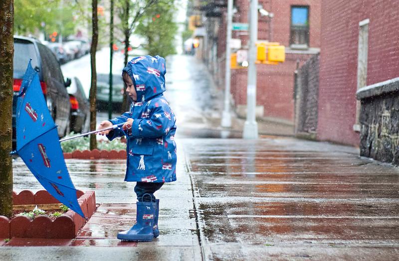 foley in raincoat and umbrella 1.jpg