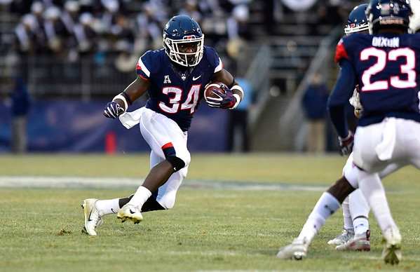 11/24/2018 Mike Orazzi | Staff UConn's Kevin Mensah (34) during Saturday's football at Rentschler Field in East Hartford.