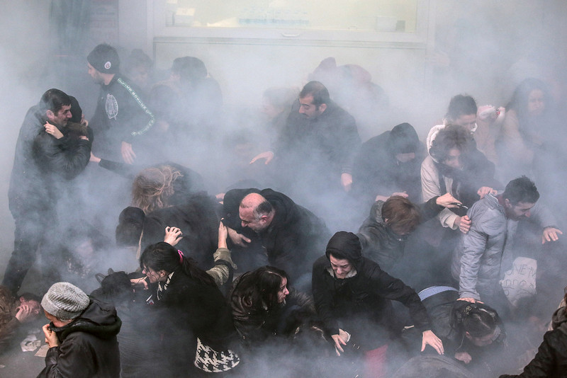 . Riot police use water cannons and teargas to disperse thousands of people marching for Berkin Elvan, a Turkish teenager who died after being in a coma since being hit in the head by a tear gas canister fired by police during the summer\'s anti-government protests, during his funeral in Istanbul, Turkey, Wednesday, March 12, 2014. On Wednesday, thousands converged in front of a house of worship calling for Prime Minister Recep Tayyip Erdogan to resign.(AP Photo/Emrah Gurel)
