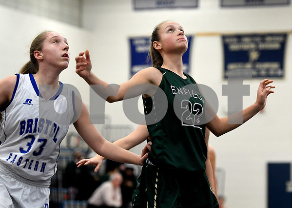 1/11/2018 Mike Orazzi | Staff Bristol Eastern's Jordan Ouellette (33) and Enfield's Kaitlyn Bourque (22) during Thursday night's girls basketball game at BE.