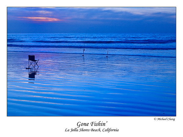 Gone Fishin'  An empty chair overlooks two fishing poles and an ocean sunset as the evening tide engulfs the shore  La Jolla Shores Beach, California  17-FEB-2008