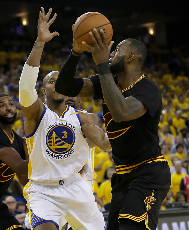 . Cleveland Cavaliers forward LeBron James, right, shoots against Golden State Warriors forward David West (3) during the second half of Game 2 of basketball\'s NBA Finals in Oakland, Calif., Sunday, June 4, 2017. (AP Photo/Marcio Jose Sanchez)