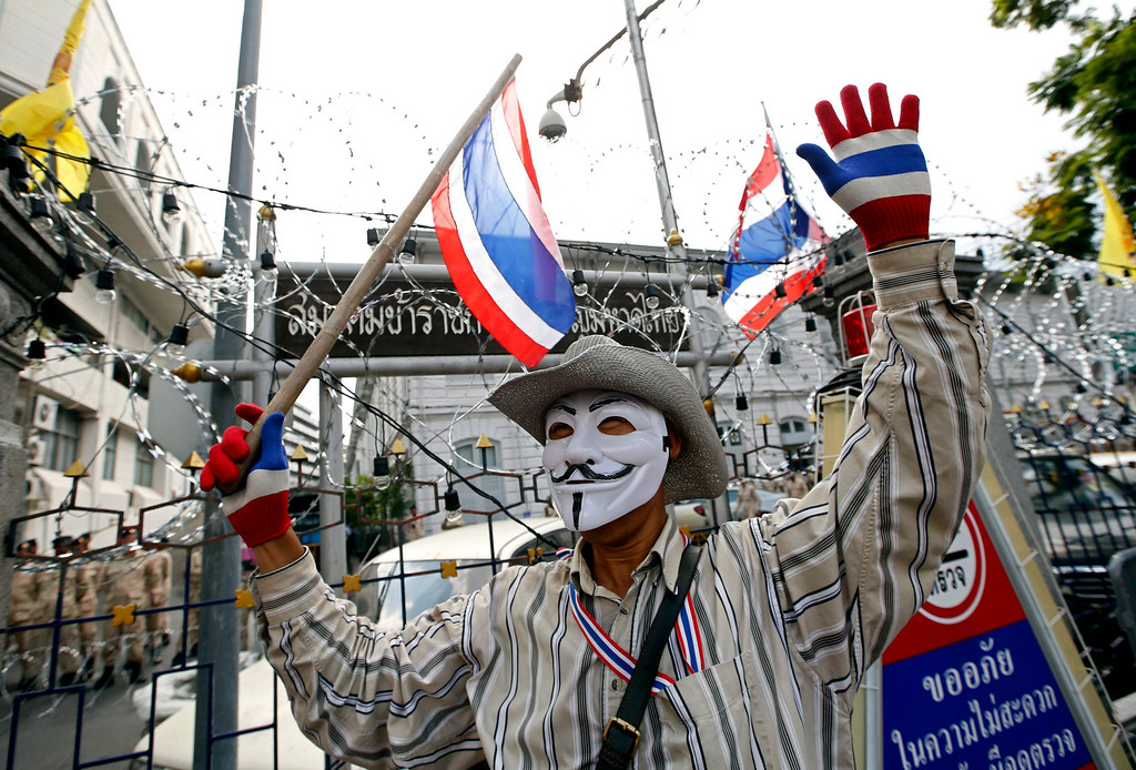 . A Thai anti-government protester cheers during a rally occupying the Interior Ministry in Bangkok, Thailand, 26 November 2013.  EPA/RUNGROJ YONGRIT