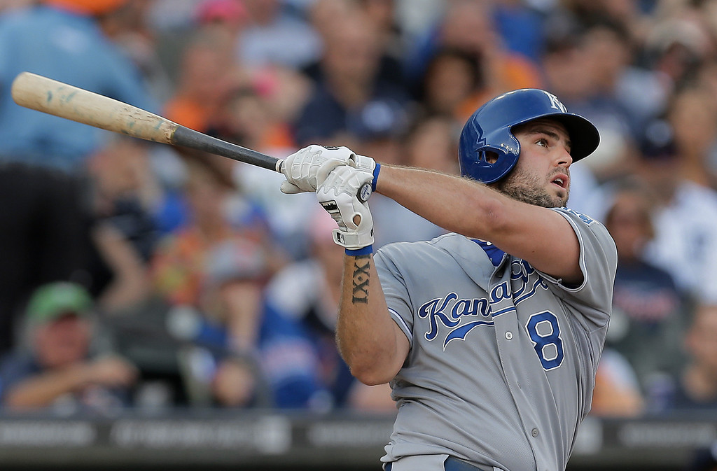 . Kansas City Royals\' Mike Moustakas hits a two-run home run against the Detroit Tigers in the second inning of a baseball game in Detroit, Tuesday, June 17, 2014.  (AP Photo/Paul Sancya)