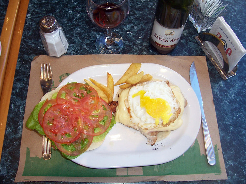 A ham, cheese, and egg open face sandwich, with a bit of wine, makes an excellent late afternoon snack.