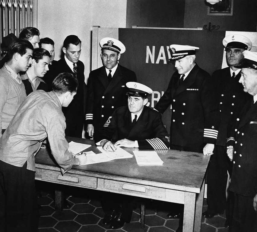 . A crowd of young men enlist in the Navy in San Francisco, Calif., Dec. 7, 1941, at the Federal Office Building.  (AP Photo)