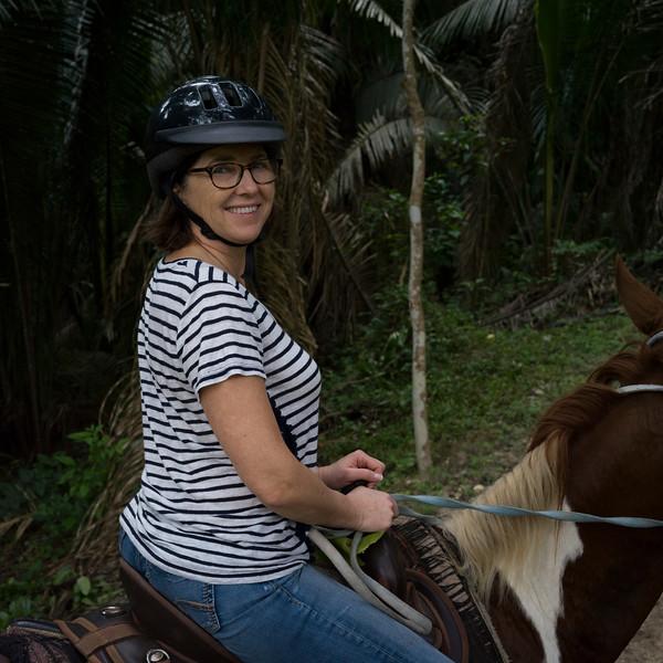 Woman riding horse, Chaa Creek Road, Chaa Creek Nature Reserve, San Ignacio, Belize
