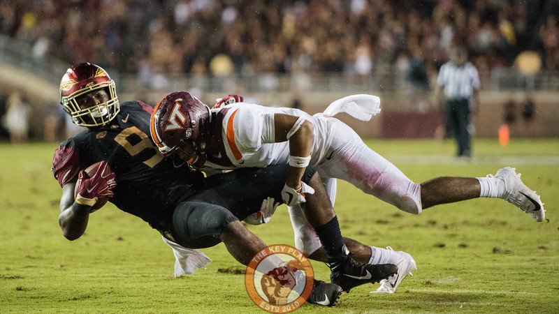 Khalil Ladler tackles FSU's Jacques Patrick in the matchup between Virginia Tech and Florida State at Doak Campbell Stadium, Monday, Sept. 3, 2018. (Photo by Cory Hancock)