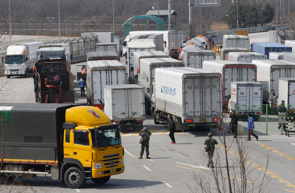 . South Korean drivers walk back to their vehicles to turn back at the customs, immigration and quarantine office in Paju, South Korea, near the border village of Panmunjom, Wednesday, April 3, 2013. North Korea on Wednesday barred South Korean workers from entering a jointly run factory park just over the heavily armed border in the North, officials in Seoul said, a day after Pyongyang announced it would restart its long-shuttered plutonium reactor and increase production of nuclear weapons material. (AP Photo/Ahn Young-joon)
