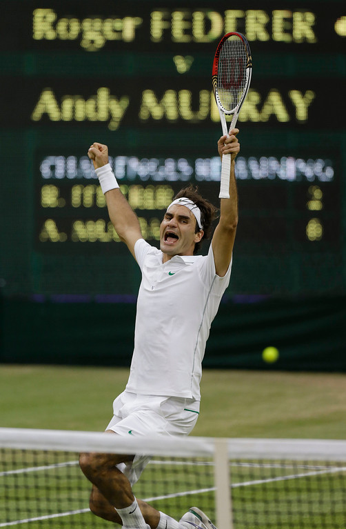 . In this Sunday, July 8, 2012 file photo made by Associated Press photographer Anja Niedringhaus, Roger Federer, of Switzerland, celebrates winning the men\'s singles final against Andy Murray of Britain at the All England Lawn Tennis Championships at Wimbledon, England.  (AP Photo/Anja Niedringhaus, File)