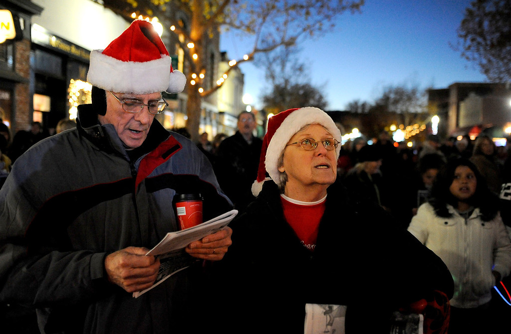 . Bill & Jackie Hampton, Suisun City sing Christmas songs along with the Mobility from Travis Air Force Base during the 31st Annual Merriment on Main celebration on Tuesday, December 3, 2013. Joel Rosenbaum/JRosenbaum@TheReporter.com