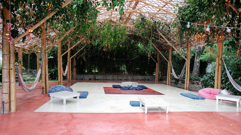 a yoga space with hammacks and mats