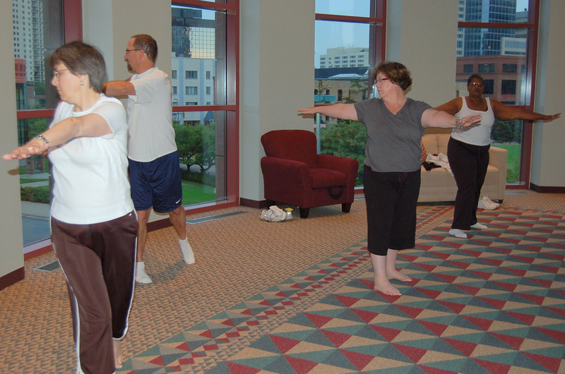 Group participates in this morning's Stretch and Pray.