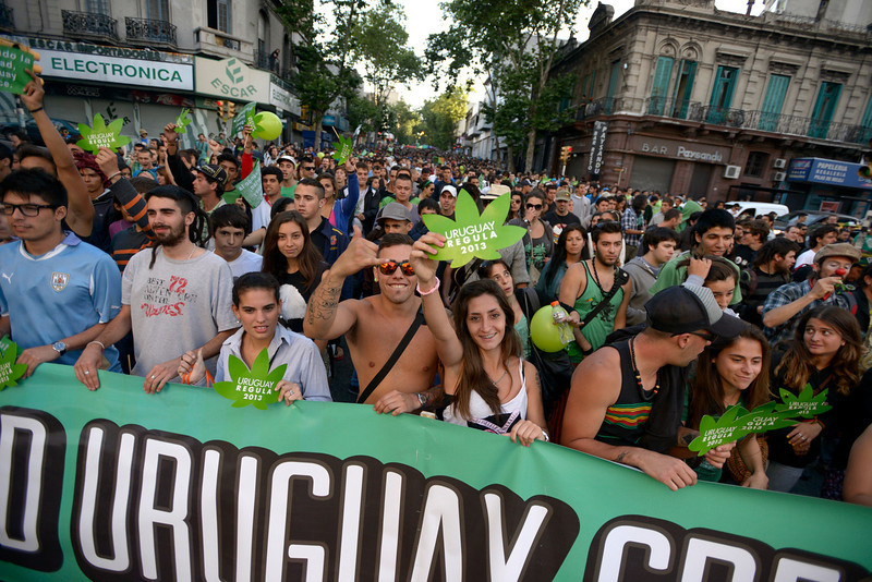 . People attend a demonstration in support of the legalization of marijuana in Montevideo, Uruguay, Tuesday, Dec. 10, 2013. Uruguay\'s Senate was finishing its final debate Tuesday before voting on a plan to create the world\'s first national marijuana market, with the state regulating the entire process of growing, selling and using a drug that is illegal almost everywhere else. (AP Photo/Matilde Campodonico)