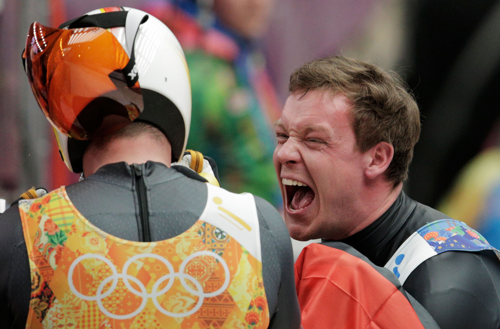 . Felix Loch of Germany celebrates with Natalie Geisenberger of Germany after their run during the Luge Relay on Day 6 of the Sochi 2014 Winter Olympics at Sliding Center Sanki on February 13, 2014 in Sochi, Russia.  (Photo by Adam Pretty/Getty Images)