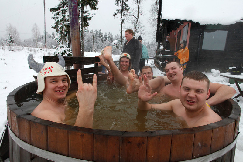 . REFILE - CORRECTING COUNTRY IN BYLINE   People react to the camera while enjoying a hot bath during the European Sauna Marathon in Otepaa February 10, 2013. More than 600 participants took part in the event by visiting 20 saunas with a total distance of over 100 km (62 miles). Picture taken February 10, 2013.  REUTERS/Ints Kalnins (ESTONIA - Tags: SOCIETY)