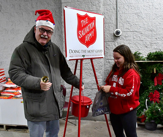 12/19/2018 Mike Orazzi   Staff State Representative Whit Betts (R-78) accepts a donation from Alida Passaretti while participating in The Salvation Army's Red Kettle Campaign by ringing bells at Walmart on Farmington Avenue in Bristol. Wednesday.