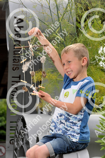 Forget crayons, felt-tips and colouring pencils, it's time to create a wild art masterpiece using nature's palette. Kai Watson aged 6 holds up his hand made mobile dream catcher made from natural pieces collected from the forest floor during the Nature's Palette Workshop at Aberdulais Tinworks and waterfalls BYLINE - www.adrianwhitephotography.co.uk