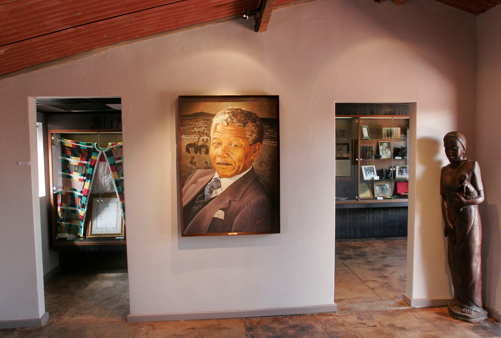 . In this photo taken on May 19, 2009,  a portrait of former president Nelson Mandela hangs in the Mandela House Museum in Soweto, South Africa. (AP Photo/Denis Farrell)