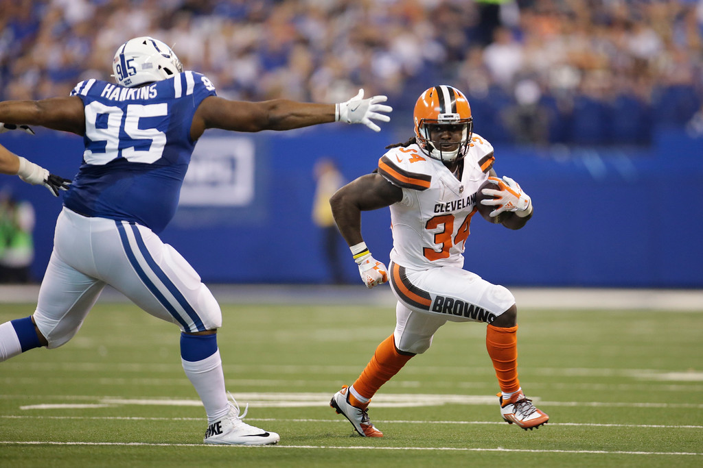 . Cleveland Browns running back Isaiah Crowell (34) runs around Indianapolis Colts defensive end Johnathan Hankins (95) during the first half of an NFL football game in Indianapolis, Sunday, Sept. 24, 2017. (AP Photo/AJ Mast)