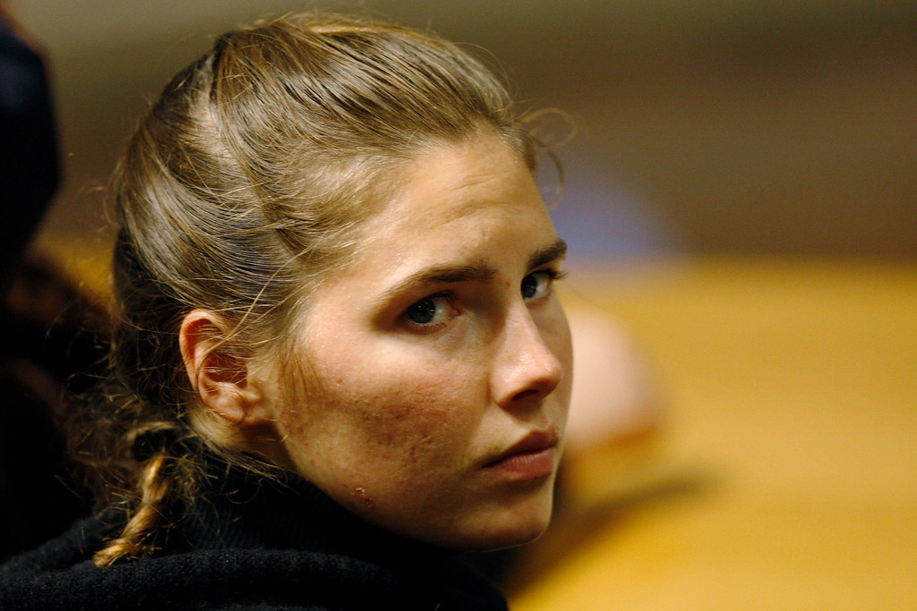 . U.S. murder suspect Amanda Knox reacts during a defence hearing by her lawyer Carlo Dalla Vedova at the court in Perugia, Italy, Tuesday, Dec.1, 2009.   (AP Photo/Luca Bruno)