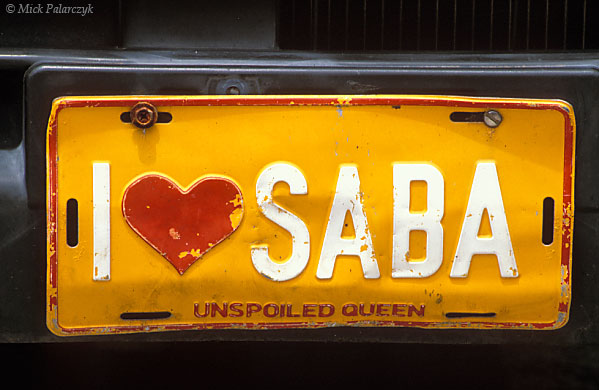 [ANTILLES.SABA 25.516] 'Number plate'.	 Although Saban motorists have only a short stretch of road at their disposal they are still clearly fond of their little island. Photo Mick Palarczyk.