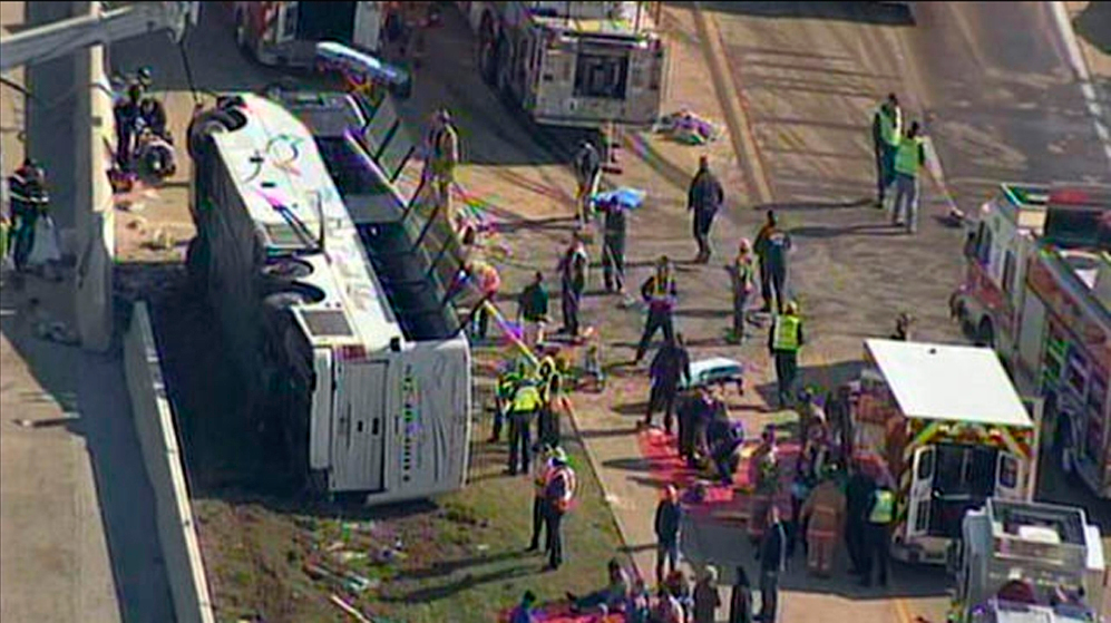 . Rescue workers surround an overturned bus on the President George Bush Turnpike in Irving, Texas April 11, 2013, in this still image taken from video courtesy NBCDFW.com.  Forty people were on board the bus when it overturned. At least 16 are believed injured according to media reports.  REUTERS/NBCDFW.com/Handout