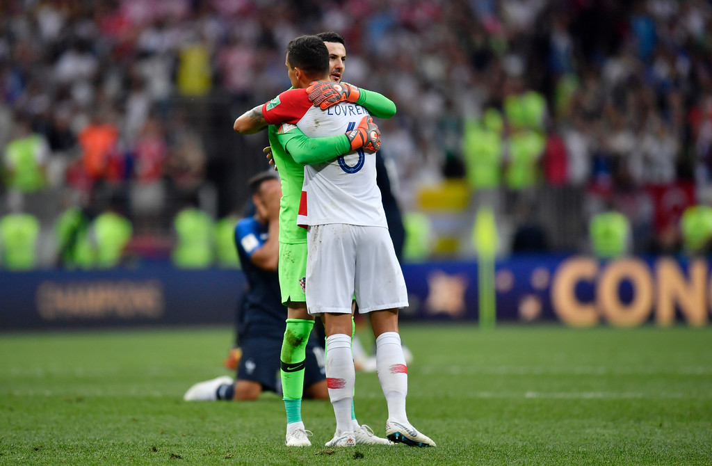 . Croatia goalkeeper Danijel Subasic comforts Croatia\'s Dejan Lovren, front, after losing during the final match between France and Croatia at the 2018 soccer World Cup in the Luzhniki Stadium in Moscow, Russia, Sunday, July 15, 2018. (AP Photo/Martin Meissner)