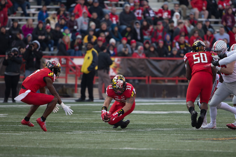 Maryland #33 LB Tre Watson recovers an Ohio State fumble