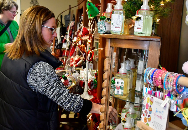 11/24/2018 Mike Orazzi | Staff Missy Ferland of Berlin while shopping at Good Cause Gifts in Berlin on Saturday.