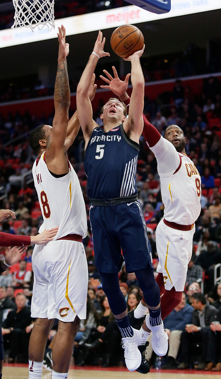 . Detroit Pistons guard Luke Kennard (5) goes to the basket against Cleveland Cavaliers forward Channing Frye (8) and guard Dwyane Wade (9) during the first half of an NBA basketball game Tuesday, Jan. 30, 2018, in Detroit. (AP Photo/Duane Burleson)