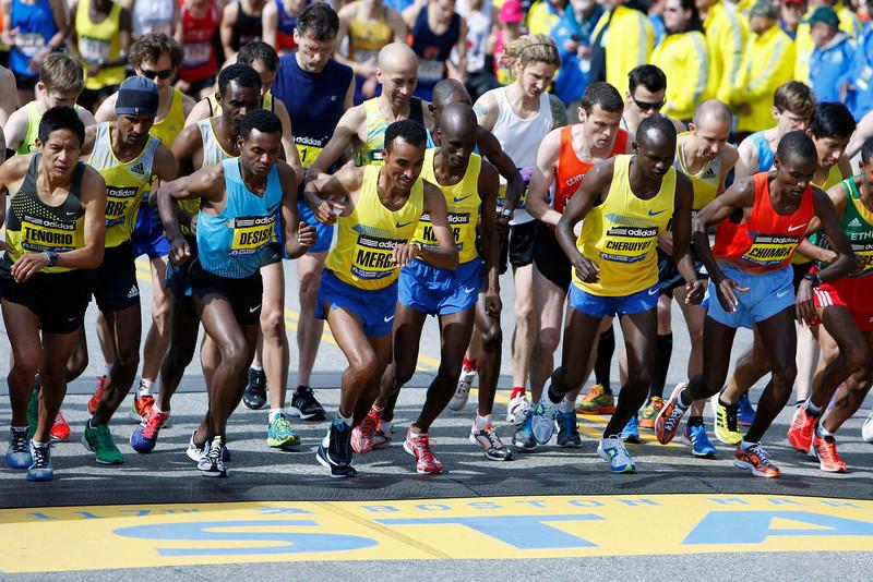 . Participants start in the elite men\'s division of the 117th running of the Boston Marathon in Hopkinton, Massachusetts April 15, 2013. REUTERS/Dominick Reuter