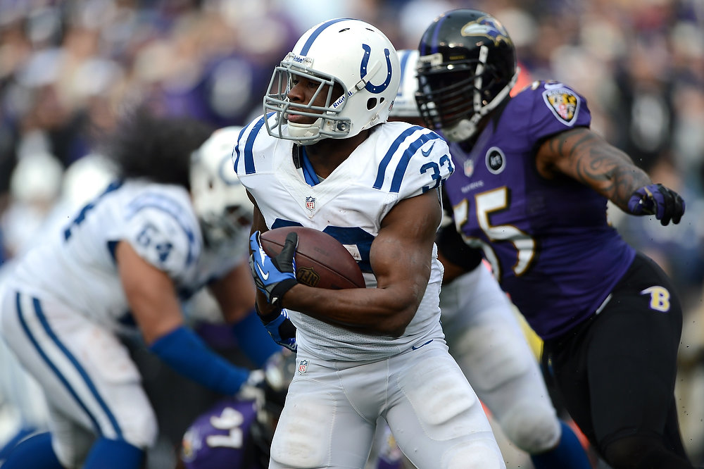 . Vick Ballard #33 of the Indianapolis Colts runs the ball against the Baltimore Ravens during the AFC Wild Card Playoff Game at M&T Bank Stadium on January 6, 2013 in Baltimore, Maryland.  (Photo by Patrick Smith/Getty Images)