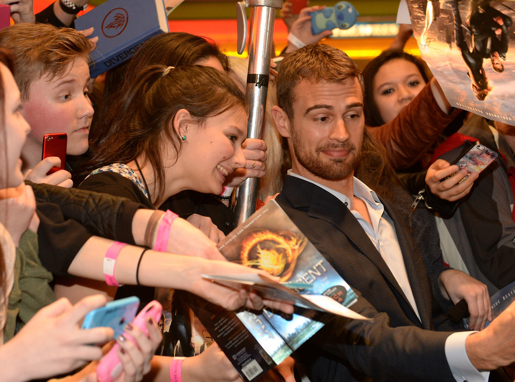 . Actor Theo James Divergent makes a personal appearance at Regal Atlantic Station on March 3, 2014 in Atlanta, Georgia.  (Photo by Rick Diamond/Getty Images for Allied-THA)